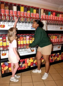 A seasonal worker helps a customer at the Jelly Belly store at Worlds of Fun.