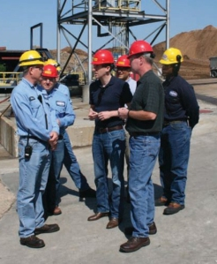 On July 9, 2014, Secretary of State Jason Kander— standing in the center with the red hard hat—visited the Kingsford Charcoal manufacturing plant in Belle.