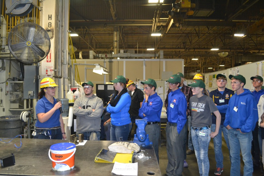 Camryn Vrbka leads a tour of Toyota-Bodine in Troy during Manufacturing Day 2015.