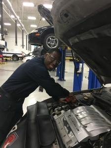 Jordan Graves works on a car